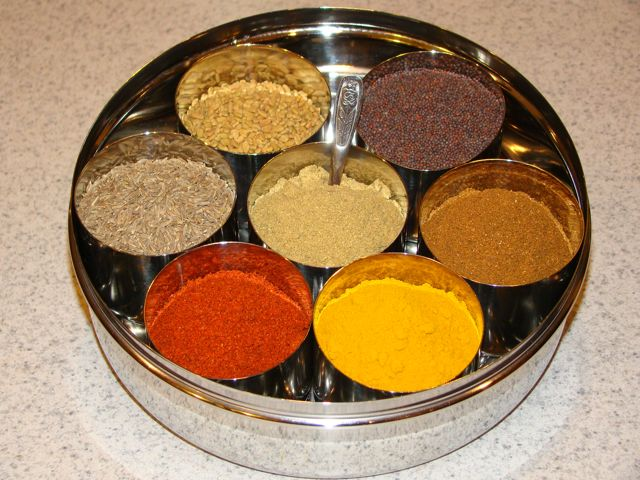 https://shriviews.files.wordpress.com/2016/06/colorful-rich-aromatic-masala-dabba-indian-spice-box.jpg