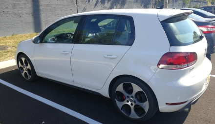 Side profile picture of a car, hatchback.